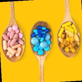 Imagem de cápsulas e comprimidos coloridos.
